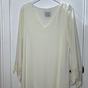 Coveted clothing cream colored dress size Sm.